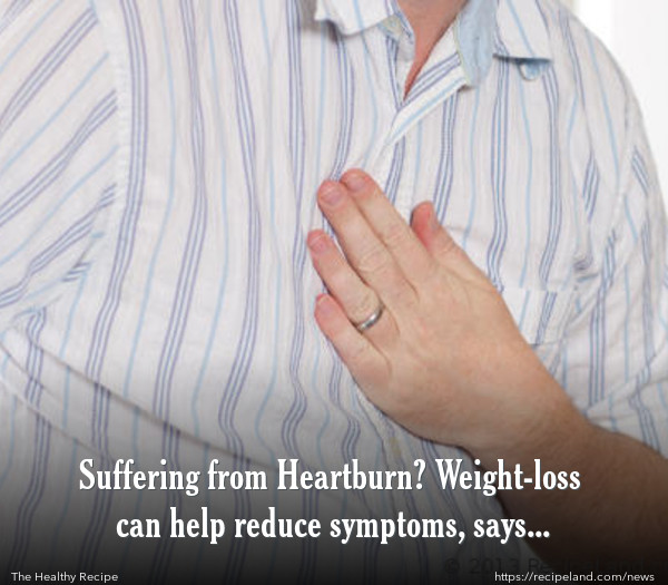 "Man suffering from ""Heart-Burn"" or Acid Reflux"