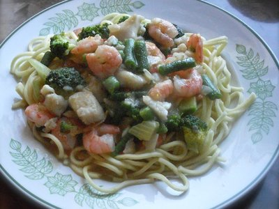 Shrimp and Fish with Green Vegetables in Orange Sauce