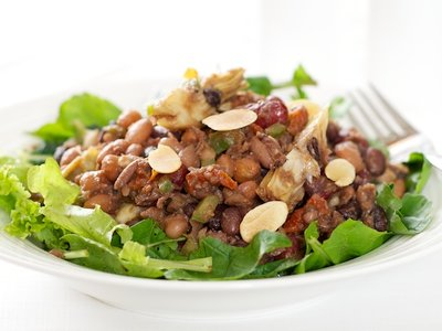 Five Bean, Artichoke and Sundried Tomato Salad with Greens and Toasted Almonds