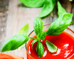 basil in tomato juice close-up