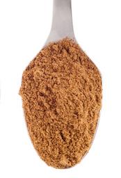 Ground cumin on a spoon